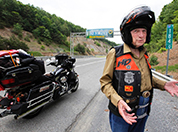 E. Bruce Heilman at age 87 stands by his Harley Davidson motorcycle near the Virginia-West Virginia border. Photo by Bob Brown, Richmond-Times Dispatch via AP