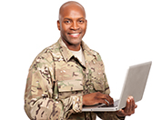 A Service member holding a laptop.