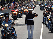 A Marine salutes Veterans riding in Rolling Thunder