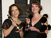 Ellen Goosenberg Kent and Dana Perry with their Oscar statues