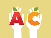One hand holding the letter A and a second hand holding the letter C