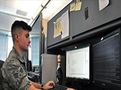 Picture of a service member working on the computer