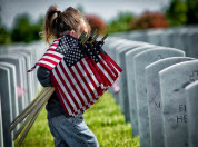 Image of girl holding American flags