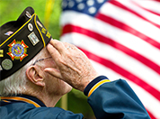 WWII Veteran saluting the flag.