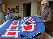 Dennis and Lynn Joynt show a quilt.