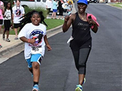 Woman and her daughter running a 5k