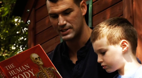 Josh reads to his son