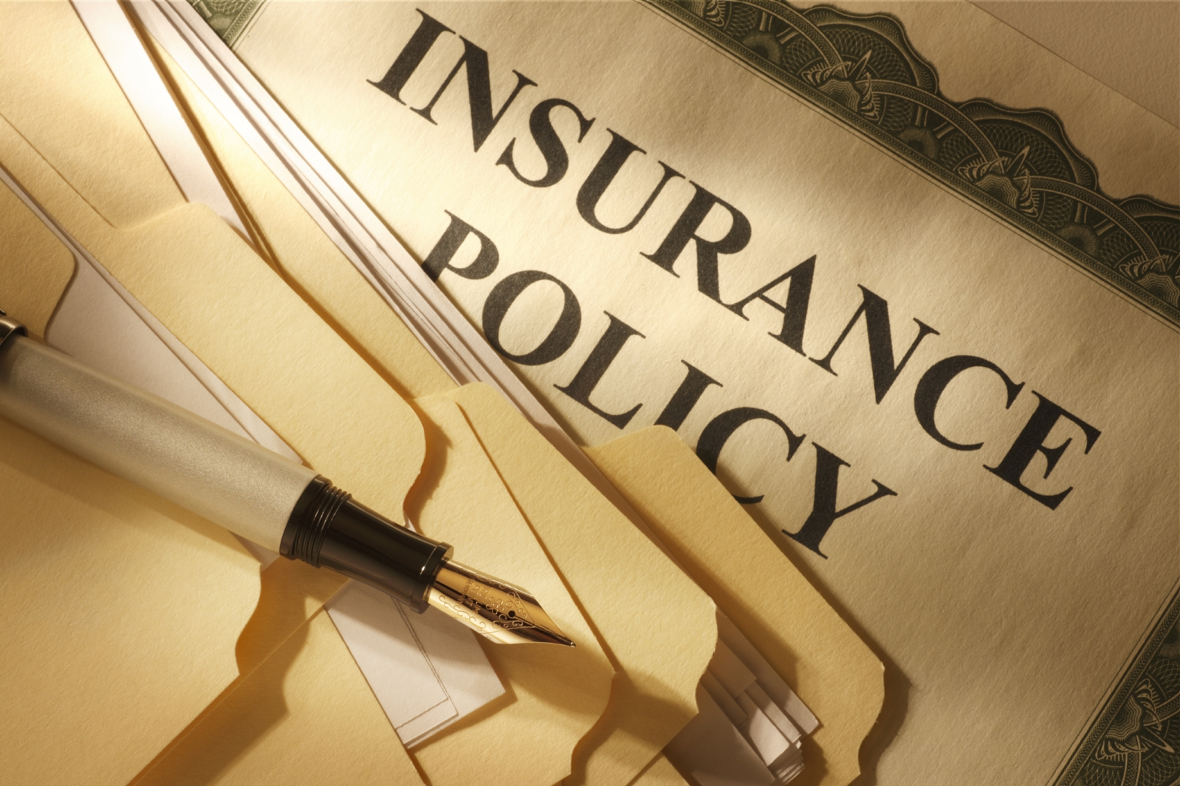 Insurance policy certificate with pen