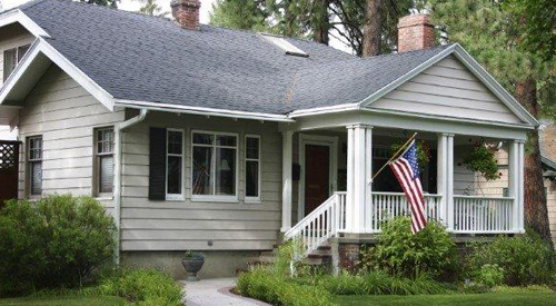 Single Family Home with U.S. Flag.