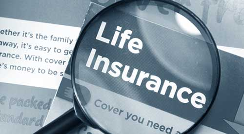 Life insurance document with magnifying glass.