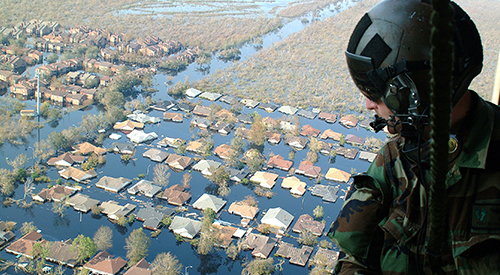 National Guardsman surveying flooding from a helicpoter