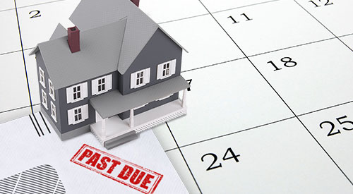 Illustration of a house setting on a calendar with a past due bill.