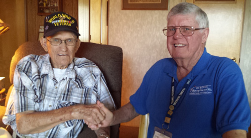 Two Veterans shaking hands.
