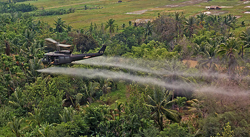 Helicopter spraying Agent Orange chemicals  in Vietnam.
