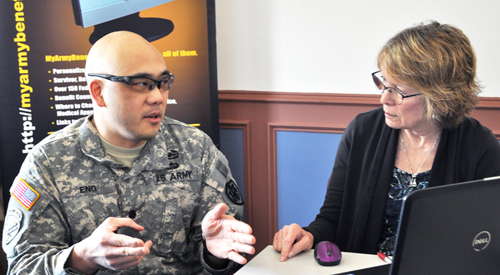 U.S. Army Servicemember speaking with a Benefits representative
