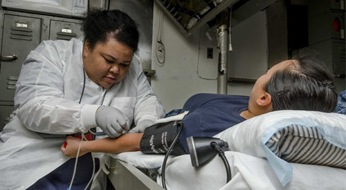 Nurse taking blood from a patient.