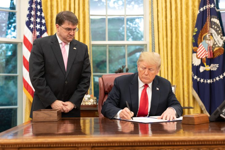 President Trump and VA Secretary Wilkie at signing in the Oval Office
