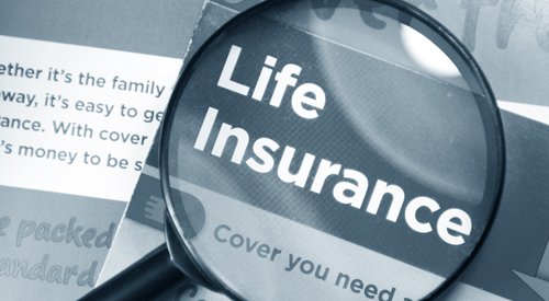 Life Insurance documents with magnifying glass.