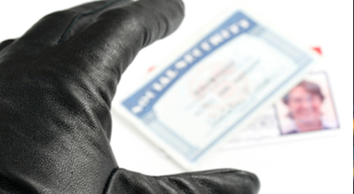 Gloved hand reaching for a social security card