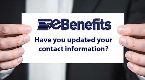Close up of a man's hands holding an eBenefit card that asks if you have updated  your contact information.
