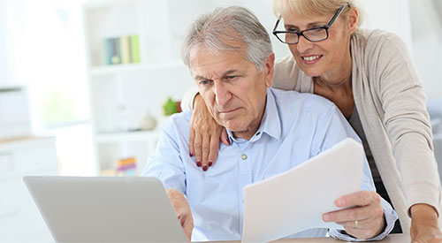 man and woman viewing documents