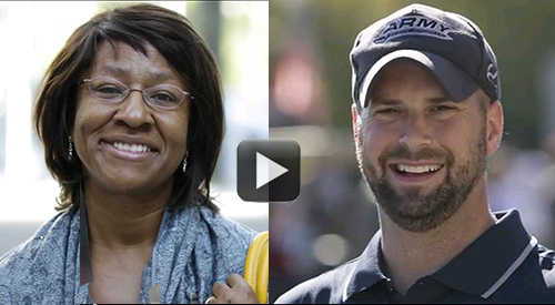 Two smiling Veterans. An African-American middle-aged woman and young Caucasian man.