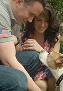 photo of serviceman with wife and dog