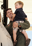 photo of serviceman holding son