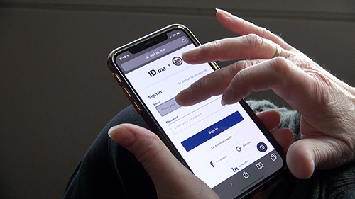 Image of person accessing policy online on a smartphone